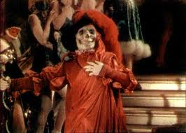 """Erik: [at the Bal Masque as """"The Red Death""""] Beneath your dancing feet are the tombs of tortured men! Thus does The Red Death rebuke your merriment!"""