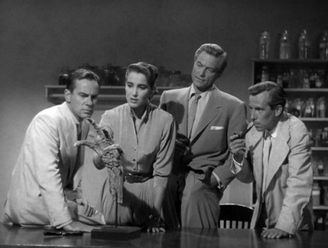 From left to right Dr. David Reed (Richard Carlson), David's girfriend and collegue Kay Lawrence (Julie Adams), Dr. Mark Williams (Richard Denning), & Dr. Edwin Thompson (Whit Bissell)Moreno)